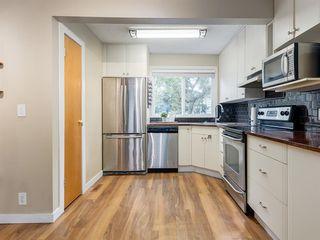 Photo 8: 49 7205 4 Street NE in Calgary: Huntington Hills Row/Townhouse for sale : MLS®# A1031333