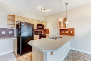 Photo 7: 21 Cimarron Vista Gardens: Okotoks Row/Townhouse for sale : MLS®# A1052331