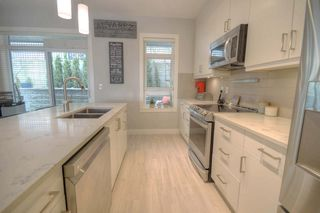 Photo 7: 120 3525 CHANDLER Street in Coquitlam: Burke Mountain Townhouse for sale : MLS®# R2449274