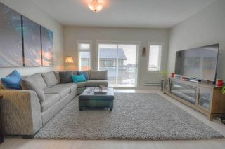 Photo 2: 120 3525 CHANDLER Street in Coquitlam: Burke Mountain Townhouse for sale : MLS®# R2449274