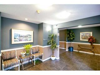 """Photo 2: 106 1200 Eastwood in Coquitlam: Condo for sale in """"LAKESIDE TERRACE"""" : MLS®# V827115"""