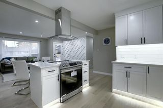 Photo 12: 704 104 Avenue SW in Calgary: Southwood Detached for sale : MLS®# A1045331