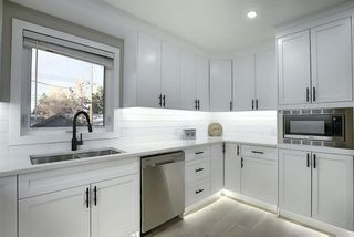 Photo 10: 704 104 Avenue SW in Calgary: Southwood Detached for sale : MLS®# A1045331