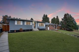 Photo 1: 704 104 Avenue SW in Calgary: Southwood Detached for sale : MLS®# A1045331