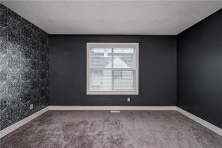 Photo 25: 312 BRIDLEWOOD Lane SW in Calgary: Bridlewood Row/Townhouse for sale : MLS®# A1046866
