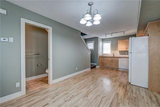 Photo 12: 312 BRIDLEWOOD Lane SW in Calgary: Bridlewood Row/Townhouse for sale : MLS®# A1046866