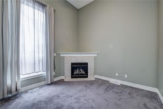 Photo 7: 312 BRIDLEWOOD Lane SW in Calgary: Bridlewood Row/Townhouse for sale : MLS®# A1046866