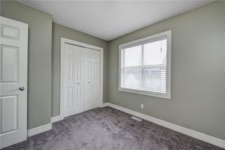 Photo 31: 312 BRIDLEWOOD Lane SW in Calgary: Bridlewood Row/Townhouse for sale : MLS®# A1046866