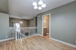 Photo 15: 312 BRIDLEWOOD Lane SW in Calgary: Bridlewood Row/Townhouse for sale : MLS®# A1046866