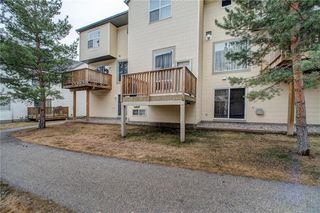 Photo 38: 312 BRIDLEWOOD Lane SW in Calgary: Bridlewood Row/Townhouse for sale : MLS®# A1046866