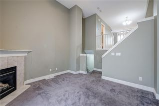 Photo 9: 312 BRIDLEWOOD Lane SW in Calgary: Bridlewood Row/Townhouse for sale : MLS®# A1046866