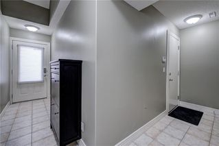 Photo 4: 312 BRIDLEWOOD Lane SW in Calgary: Bridlewood Row/Townhouse for sale : MLS®# A1046866