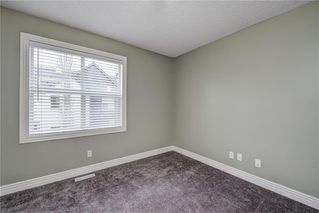 Photo 30: 312 BRIDLEWOOD Lane SW in Calgary: Bridlewood Row/Townhouse for sale : MLS®# A1046866