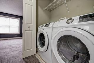 Photo 34: 312 BRIDLEWOOD Lane SW in Calgary: Bridlewood Row/Townhouse for sale : MLS®# A1046866