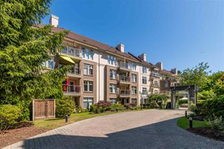 "Photo 1: 201 15350 19A Avenue in Surrey: King George Corridor Condo for sale in ""STRATFORD GARDENS"" (South Surrey White Rock)  : MLS®# R2465076"