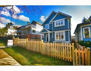 Photo 1: 1962 E 3RD Avenue in Vancouver: Grandview VE House 1/2 Duplex for sale (Vancouver East)  : MLS®# V695012