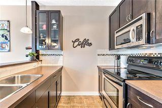 Photo 7: 115 Cimarron Vista Garden: Okotoks Row/Townhouse for sale : MLS®# C4275814