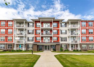 Main Photo: 310 1 Crystal Green: Okotoks Apartment for sale : MLS®# C4293895