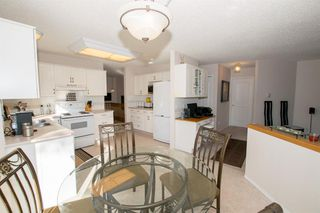 Photo 19: 54 SIERRA MORENA Green SW in Calgary: Signal Hill Semi Detached for sale : MLS®# A1030689