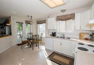Photo 16: 54 SIERRA MORENA Green SW in Calgary: Signal Hill Semi Detached for sale : MLS®# A1030689