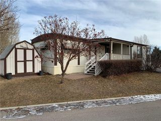 Photo 1: 166 99 ARBOUR LAKE Road NW in Calgary: Arbour Lake Mobile for sale : MLS®# A1032510
