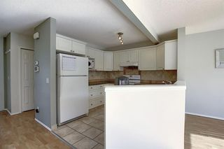 Photo 17: 117 ROCKY RIDGE Point NW in Calgary: Rocky Ridge Detached for sale : MLS®# A1036366