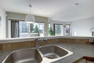 Photo 8: 117 ROCKY RIDGE Point NW in Calgary: Rocky Ridge Detached for sale : MLS®# A1036366