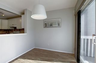 Photo 11: 117 ROCKY RIDGE Point NW in Calgary: Rocky Ridge Detached for sale : MLS®# A1036366