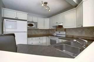 Photo 9: 117 ROCKY RIDGE Point NW in Calgary: Rocky Ridge Detached for sale : MLS®# A1036366
