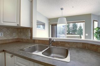 Photo 7: 117 ROCKY RIDGE Point NW in Calgary: Rocky Ridge Detached for sale : MLS®# A1036366