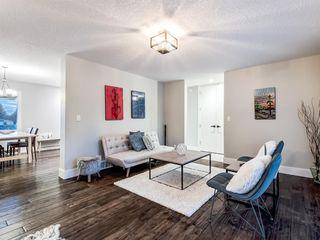 Photo 9: 9407 22 Street SW in Calgary: Palliser Detached for sale : MLS®# A1038500