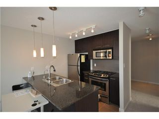 "Photo 3: # 709 2979 GLEN DR in Coquitlam: North Coquitlam Condo for sale in ""ALTAMONTE"" : MLS®# V847188"