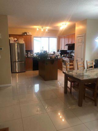 Photo 8: 1409 76 Street in Edmonton: Zone 53 House for sale : MLS®# E4222608
