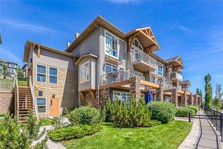 Main Photo: #8 124 ROCKYLEDGE View NW in Calgary: Rocky Ridge Row/Townhouse for sale : MLS®# A1054926