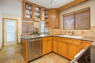 Photo 8: 10528 SUNCREST Drive in Delta: Nordel House for sale (N. Delta)  : MLS®# R2525886