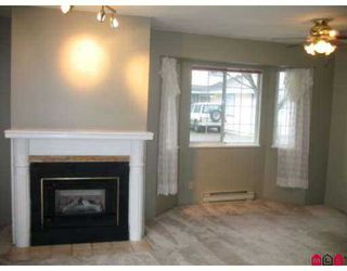 """Photo 5: 5360 201ST Street in Langley: Langley City Townhouse for sale in """"GARDEN GROVE"""" : MLS®# F2703996"""