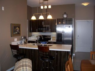 """Photo 1: 603 22318 LOUGHEED Highway in Maple Ridge: West Central Condo for sale in """"223 North"""" : MLS®# R2444122"""