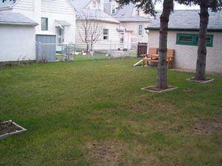 Photo 8: 301 SINCLAIR Street in Winnipeg: North End Single Family Detached for sale (North West Winnipeg)  : MLS®# 2505568