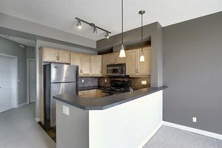 Photo 9: 4 145 Rockyledge View NW in Calgary: Rocky Ridge Apartment for sale : MLS®# A1041175
