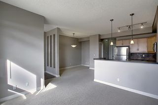 Photo 8: 4 145 Rockyledge View NW in Calgary: Rocky Ridge Apartment for sale : MLS®# A1041175