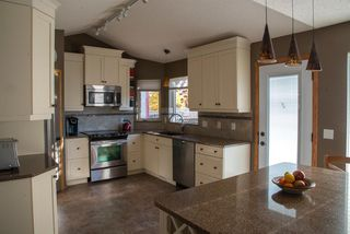 Photo 8: 104 Hawkland Circle NW in Calgary: Hawkwood Detached for sale : MLS®# A1041091