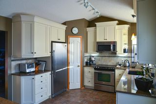 Photo 7: 104 Hawkland Circle NW in Calgary: Hawkwood Detached for sale : MLS®# A1041091