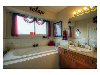 Photo 7: 23766 115A AV in Maple Ridge: Cottonwood MR House for sale : MLS®# V868444