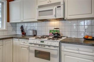 Photo 11: 33 5616 14 Avenue SW in Calgary: Christie Park Row/Townhouse for sale : MLS®# A1029523