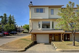 Photo 2: 100 PATINA Park SW in Calgary: Patterson Row/Townhouse for sale : MLS®# A1031053