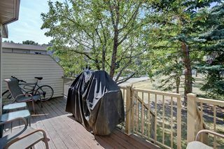 Photo 28: 100 PATINA Park SW in Calgary: Patterson Row/Townhouse for sale : MLS®# A1031053