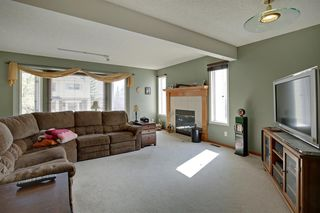 Photo 5: 100 PATINA Park SW in Calgary: Patterson Row/Townhouse for sale : MLS®# A1031053