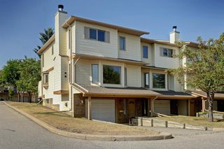 Photo 1: 100 PATINA Park SW in Calgary: Patterson Row/Townhouse for sale : MLS®# A1031053