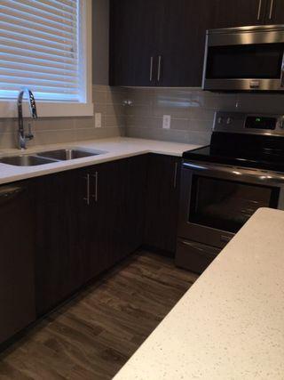 Photo 5: 104 903 Crystallina Nera Way in Edmonton: Zone 28 Townhouse for sale : MLS®# E4181345