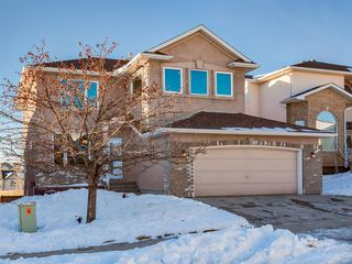 Photo 1: 64 Simcoe Close SW in Calgary: Signal Hill Detached for sale : MLS®# A1058933